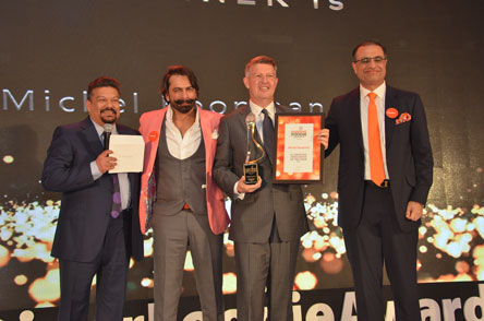 Michel Koopman, General Manager, receiving award from (L-R) Vir Sanghvi, Jai Arora and Kapil Chopra