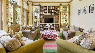 Library and TV Room at 7 Pines Hotel