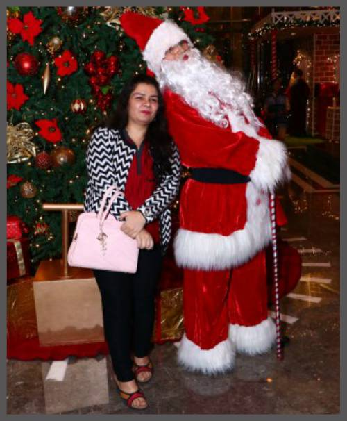 Anjali stand with Santa